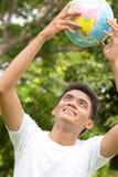 Värld i min händer Arkivfoto