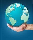 Värld som lutar över en hand Royaltyfria Foton