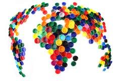 Världsöversikt från plastic lock Arkivbilder