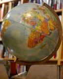 Världsjordklot för global by Royaltyfri Foto