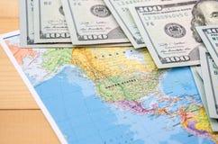 Världskarta och dollar för bakgrund royaltyfri foto