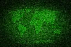 Världskarta på bakgrund för fält för grönt gräs Royaltyfri Fotografi