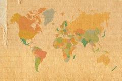 Världskarta på pappbakgrund Royaltyfria Bilder