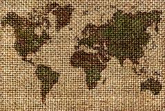 Världskarta som dras på en buse, gamla tyger Arkivfoto
