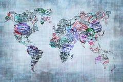Världskarta som skapas med passstämplar Arkivfoto