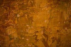 Värme brunt målad bakgrund Arkivfoto