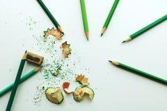 Vässare med gröna blyertspennor vektor illustrationer