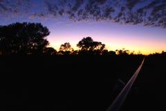 Västra australisk soluppgång för vildmarkrörledningkonstruktion Arkivfoton