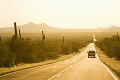 västra vägsolnedgång Arkivbild