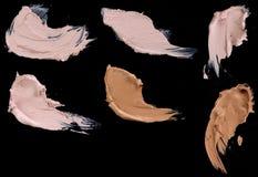 Vätskepulverslaglängder för olikt smink Royaltyfri Foto