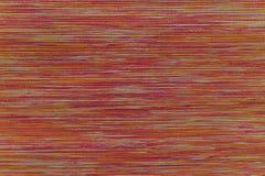 Vävd tygtextur, slut upp av röd bakgrund för textur för tyg för signalfärg Royaltyfri Bild