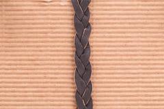 Vävt brunt läderbälte Arkivfoto