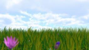 Växande blommor och gräs