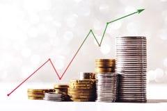 Växande myntbuntar Arkivbild