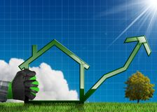 Växande Real Estate försäljningar - graf med huset Arkivbild