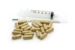 Växt- drogkapsel och injektionsspruta Arkivbilder