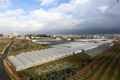 Växthus på ett fält Royaltyfria Foton