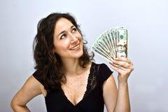 våg kvinna för pengar Royaltyfri Bild