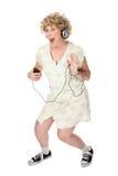 våg kvinna för rolig musikspelare Arkivfoton