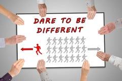 Våga för att vara det olika begreppet på en whiteboard Fotografering för Bildbyråer