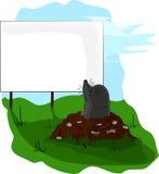 Vågbrytare på mullvadshög som ser en affischtavla. Arkivbilder