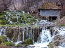 Vårar av Taor med ett gammalt vattendrag arkivfoton