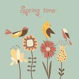 Vårblommor och fåglar. Arkivbild