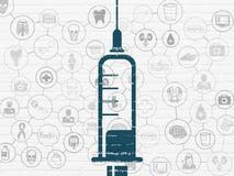 Vård- begrepp: Injektionsspruta på väggbakgrund Arkivfoton