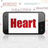 Vård- begrepp: Smartphone med hjärta på skärm Arkivfoton