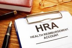 Vård- ersättningkonto HRA med skrivplattan royaltyfria bilder