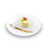 Vård- vegetariska ris med tomaten och smör på en rund platta Royaltyfri Fotografi