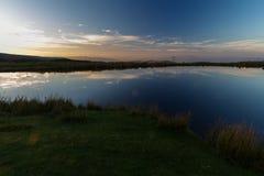 Vårdaredamm, Blorangen Höglandvatten på solnedgången Royaltyfria Foton