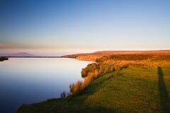 Vårdaredamm, Blorangen Höglandvatten på solnedgången Arkivfoton
