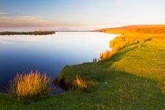 Vårdaredamm, Blorangen Höglandvatten på solnedgången Arkivbilder