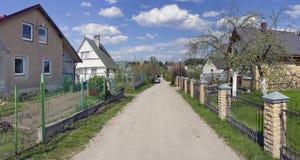 Vårtid i litauisk by Arkivbild