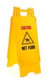 våt yellow för golvtecken arkivfoto