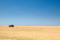 Véhicule dans le désert Photo libre de droits