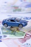 Véhicule et argent Photographie stock