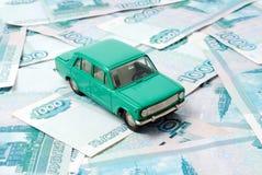 Véhicule et argent Photographie stock libre de droits