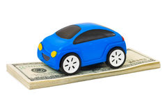 Véhicule et argent de jouet Photo stock
