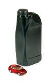 Véhicule et boîte de l'huile à moteur Photo stock