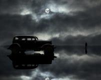 Véhicule, homme et lune photographie stock