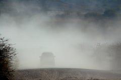 Véhicules dans la poussière Photos libres de droits