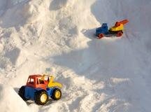 Véhicules de jouet dans la neige Photos libres de droits