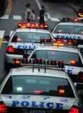 Véhicules de police exploités en gradins Photo libre de droits