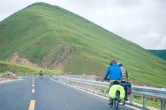 Vélo de montagne de recyclage de personnes Photo stock