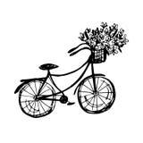 Vélo tiré par la main avec des fleurs Photo libre de droits