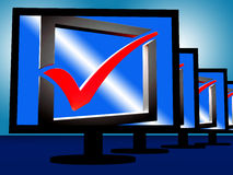 Vérifiez Mark On Monitors Showing Approved Photographie stock libre de droits