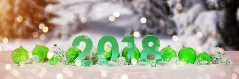 véspera de ano 2018 novo com quinquilharias do Natal e velas do renderin de 3D Imagens de Stock