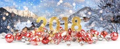 véspera de ano 2018 novo com rendição das quinquilharias 3D do Natal Foto de Stock